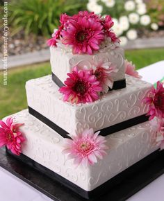 Square Wedding Cake with Pink Daisies and Black Ribbon