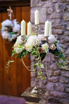Our beautiful Roses, Dahlias, Hydrangeas, Stocks and Ivy trails with strings of pearls draping between the candelabras branches