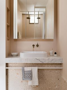 Peach walls, terrazzo tiles, and a marble vanity make for a stylish and contemporary bathroom design in Storybook House by Folk Architects. Stone Kitchen Island, Functional Planning, Terrazo, Freestanding Fireplace, Tadelakt, Kitchens And Bedrooms, Victorian Terrace, Victorian Era, Japanese Interior