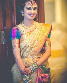 South Indian bride. Gold Indian bridal jewelry.Temple jewelry. Jhumkis.Cream silk kanchipuram sari.Braid with fresh jasmine flowers. Tamil bride. Telugu bride. Kannada bride. Hindu bride. Malayalee bride.Kerala bride.South Indian wedding.
