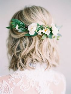 26 Short Wedding Hairstyles And Ways To Accessorize Them: a wavy hairstyle with fresh white blooms and greenery on the back for a romantic bride; #bridalhair