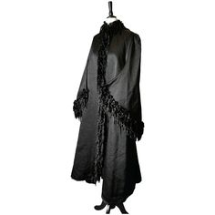 An absolutely excuisite Victorian mourning coat with dolman sleeves, adorned with velvet and real jet beads.pThis decadent and rich inky black mourning piece is a museum worthy piece, so expertly put together from the finest of materials.pIt is made from a very heavy thick ribbed silk bombazine which was a popular fabric for mourning wear of the period and particularly used in first mourning pieces, it has a short collar crafted in black lace, with tiny black jet bead detailing around the neckli Victorian Coat, Victorian Life, Covered Buttons, Jet, Period, Museum, Velvet, Fashion Outfits, Popular