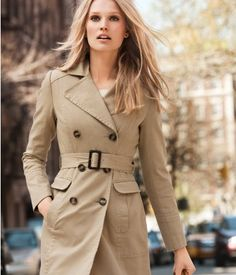Proportion. This coat show proportion, because both the belt and the buttons are moderately sized.