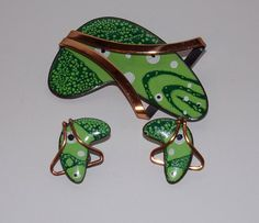 """The earrings are clip on they are signed as is the brooch. The brooch is large and measures 2 5/8"""" x 1 5/8"""" at the widest part. The color is fabulous, deep green lime green and white on bright copper."""