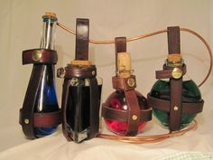 I need a costume for these!  Leather potion bottle holder - Triangle shaped. $15.00, via Etsy.