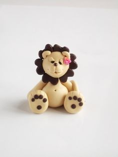 Polymer clay miniature lion. $14.00, via Etsy.