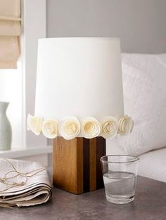Use the paper roses to decorate a shade... This with vintage book pages or sheet music roses.