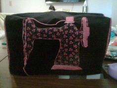 Sewing Machine cover. Sure helps keep the cat fur out of the machine!