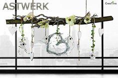 Astwerk. Frühlingshaft dekorierter Ast. http://creatina-dekoshop.de/Themenwelten/Astwerk/