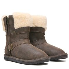 Get a winter take on the bomber boot in the Madison Winter Boot from Bearpaw.Suede or faux leather upper in a winter boot style with a round toeYKK® zipper entryWool blend collar8 inch shaft heightBearpaw® branded buckle and rivetsWool blend lining and sheepskin footbedClassic low profile TPR outsole