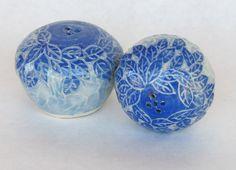 wheel thrown ceramic salt & pepper shakers. Blue underglaze leaf carved design. Sky blue celadon glaze to finish. (gabart.co) Kitchen Items, Handmade Pottery, Glaze, Pepper, Salt, Carving, Ceramics, Pattern, Design
