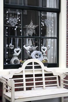 White ornaments and trimmings adorn the front window of this downtown dwelling.