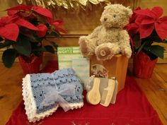 """Welcome new (and experienced) parents! 118 main has what you need to make your little ones giggle and make date night easier. Hand Crochet Blanket ( $75) Baby Brush Set ($17) Leo Bear ($30) Parents Night Out Pad ($6.50) """"Dear Babysitter"""" Pad ($10)"""