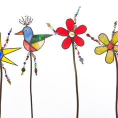 """These Gardenstakes are some of my most popular items. Each is unique in color combination and no two will ever be alike. Price shown is for ONE of either Flower, Star or Bird. They are created from Artglass, copper tubing, glass beads and copper, brass wiring, copperfoil and solder. They vary in size, actual bird, flower and star will be around 5.5"""" in diameter, the height varies from 17"""" to 22""""Limited Production"""