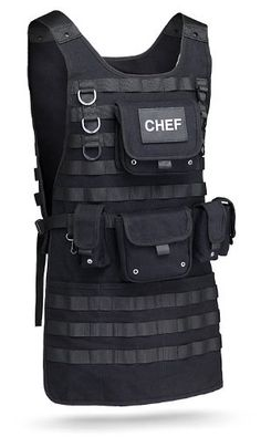 Get ready for an awesome cookout party with this Tactical BBQ Apron from ThinkGeek. This must-have item incorporates a real MOLLE system to allow you to hold everything that the grill master in you needs to cook with precision. Bbq Apron, Chef Apron, Grill Apron, Barbacoa, Velcro Patches, Kitchen Aprons, Kitchen Stuff, Grill Master, Balenciaga City Bag