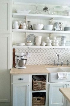 Country Kitchen with One-wall, Shaker style cabinetry, Farmhouse sink, Ceramic tile backsplash, Open shelving, Stone Tile