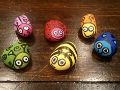 Rock bugs. Acrylic on pebbles painted for our neighbors daughter - SOLD