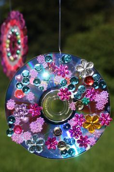 CD WIND SPINNERS:  Turn your old, scratched cds and dvds into gorgeous hanging ornaments for your patio, deck or balcony.  You should SEE them spin!  They go crazy! - Happy Hooligans