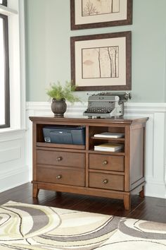 Ashley Burkesville H565-40 Signature Design Burnished Brown Home Office Cabinet - When entertaining guests and family, you want to make sure that the accent pieces in your living space have the proper colors of warmth, invitation and general beauty. Within this collection, you can find all that and more. Please make yourself at home with this and other great furniture pieces from Ashley Furniture.