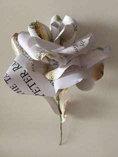 Beautiful hand made upcycled paper rose made from a vintage Peter Rabbit story book. Made to order by Karolina Rose.