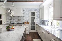 Pretty Kitchen Design - White Marble Countertops - Gray Flower-Mosaic Tile Backsplash - Dana Benson Construction