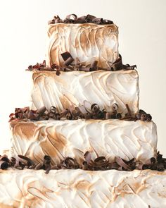 """A twist on the childhood indulgence, this confection combines graham cake with chocolate ganache, marshmallows, and vanilla buttercream. We """"toasted"""" the swiss meringue frosting with a chef's torch for that straight-from-the-campfire flavor and added chocolate curls for extra appeal."""