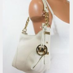 Ivory Michael Kors shoulder bag Ivory Michael Kors shoulder bag ⭐️AUTHENTIC⭐️ used but has plenty of life left. Handle shows wear and small scuff on bottom (un-noticeable). NO PAYPAL. Will accept reasonable offers. Michael Kors Bags Shoulder Bags