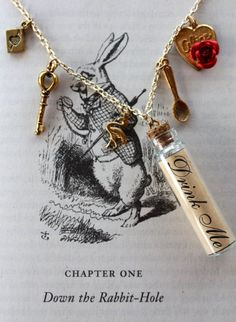 Etsy Alice in Wonderland 'Drink Me' Charm Necklace, An Ace of Hearts playing card, a key, a flamingo, a bottle labeled 'Drink Me', a tea spoon and finally an 'alice' charm with a red rose attached. $17