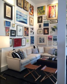 Need Therapy? another idea-gallery wall of lots of different art pieces on family room wall