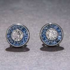 Diamond Sapphire and Platinum Studs | From a unique collection of vintage stud earrings at https://www.1stdibs.com/jewelry/earrings/stud-earrings/
