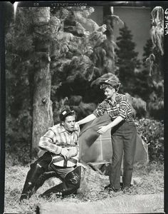 I Love Lucy scene when Lucy goes camping to show Ricky she fits in with his hobbies.  In the fishing contest....She has Ethyl hiding in the woods and bringing her fish from the grocery store.