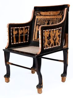 Sessel in massivem Holz gefertigt, weitgehend ebonisiert, nach ägyptischen Vorbildern des Neuen Reichs Ägyptens, in üblicher Weise mit nahezu zu amorphen ...