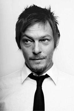 Smirking, raised brow, black and white photo, facial hair, mole, tie.... F*CK! He's so hot.
