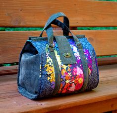 Nora is a classic handbag inspired by doctor bag purses of the past. True to the style, this bag opens wide but does not require an expensive frame. Three sizes are included in this sewing pattern.