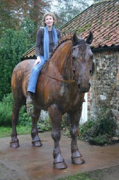 The sculptor Harriet Mead on her Suffolk horse - look closely! Go to the linked website to see many of her works of art.