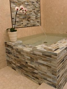 Bathtub for two, waterfalls into the shower