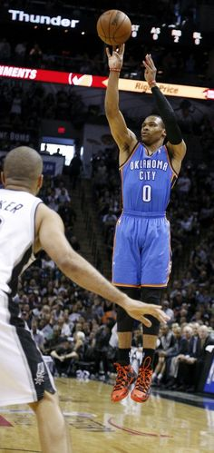 Oklahoma City's Russell Westbrook (0) shoots near San Antonio's Tony Parker (9) during Game 5 of the Western Conference Finals in the NBA playoffs between the Oklahoma City Thunder and the San Antonio Spurs at the AT&T Center in San Antonio, Thursday, May 29, 2014. Photo by Sarah Phipps, The Oklahoman