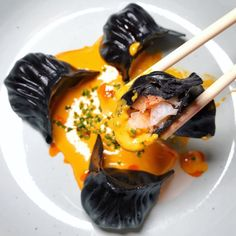 Step up your dim sum game w/ @riceandgold's Lobster & Scallop Hargow! Plumpy seafood & leek dumplings in squid ink wraps served w/ a luscious Sauce Americaine.  Their pho soup dumplings are also a must! Lots of tasty dishes by Chef @jae.s.lee at @daletalde's cool new Asian spot at the @50bowery hotel.