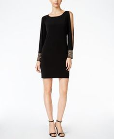 A modern take on the Lbd, this Calvin Klein dress features slitted sleeves that culminate in ample cuffs heavily embellished with glistening beads of silver- and gold-tone. | Polyester/spandex; lining