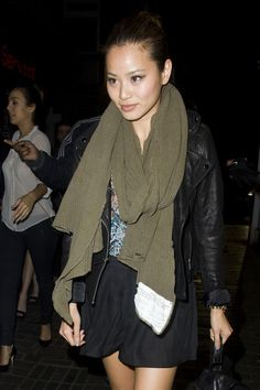 Jamie Chung Knit Scarf - Jamie is bundled up in a thick olive knit scarf and a cropped leather jacket.