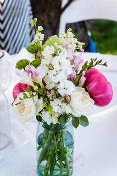 wild flowers in mason jars as center pieces #vintagewedding #weddingdetails #elizabethsostizzophotography