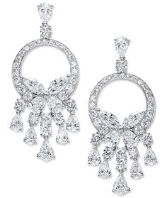 Cellini Jewelers Butterfly Hoop Diamond Earrings Marquise and pear-shaped diamonds form a butterfly that rests on a hoop of diamonds, with graduating rows of pear and brilliant-cut diamond drops; a pear and brilliant-cut diamond at the top secures a post and clip back, in 18-karat white gold.