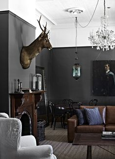 Moody + Inviting Home Tour Of Designer Tracie Ellis |via decor8. Note the painted line at the top of the room. And dark on dark below. Yum.