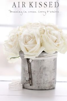 details | silver metal planter | white roses | skeleton key | flower arragngement | bouquet