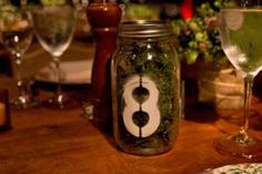 "Here's an on-theme idea for a rustic farm-to-table dinner: At last year's Lowline ""Anti-Gala,"" moss-filled Mason jars served as table numbers."
