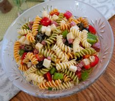 Pasta Salad  Italian Dressing, tricolor pasta, salami, provolone or pepperjack cheese, cherry tomatoes, red bell pepper, chopped green pepper, olives