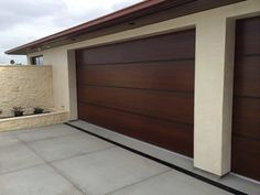 Interesting garage doors for you guys to think about. African Mahogany Contempor… Sponsored Sponsored Interesting garage doors for you guys to think about. African Mahogany Contemporary Wood Garage Door with Anodized Aluminum Bands – Tungsten Royce 1 Brown Garage Door, Garage Doors For Sale, Garage Door Colors, Garage Door Panels, Contemporary Garage Doors, Modern Garage Doors, Wood Garage Doors, Custom Garage Doors, Contemporary Style
