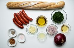 Here are all the ingredients you need to make choripan and fresh chimichurri. Choripan is a staple of Argentinian cuisine, often sold as street food. It's essentially a grilled chorizo sausage inside a toasted baguette topped with a dollop of chimichurri.