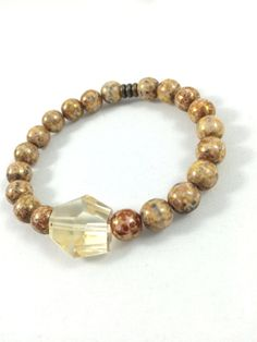 https://www.etsy.com/listing/211806782/gold-citrine-beaded-bracelet-handmade?ref=shop_home_active_24