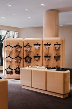 Customers can try on items inside the thick-walled changing rooms which are framed with soft pink curtains. As they shop, visitors can also enjoy macaroons by pastry chef and chocolatier Pierre Hermes, which come in the same neutral colours as the collection.
